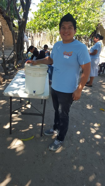 2016-03-23 Village Outreach - Freddy Hauling Water for Children to Drink