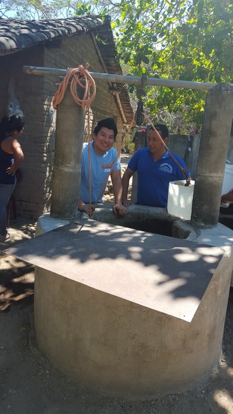 2016-03-23 Village Outreach - Freddy getting well water for Children to drink (Copy)